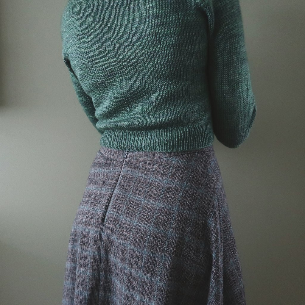 A close shot of the back of the skirt, shewing the grey zipper.
